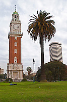 The Big Ben like clock tower called Torre de los Ingleses (the Englishmen's tower) renamed Torre Monumental (Monumental Tower) on the Plaza San Martin Square renamed Plaza de la Fuerza Aerea or Plaza Fuerza Retiro, big palm tree and modern tower building. Buenos Aires Argentina, South America