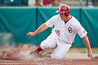 Drew Harrison (45) slides into home during the NCAA matchup between the University of Arkansas-Little Rock Trojans and the University of Oklahoma Sooners at L. Dale Mitchell Park in Norman, Oklahoma; March 11th, 2011.  Oklahoma won 11-3.  Photo by William Purnell/Four Seam Images