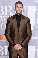 LONDON, UK. February 20, 2019: Calvin Harris arriving for the BRIT Awards 2019 at the O2 Arena, London.<br /> Picture: Steve Vas/Featureflash<br /> *** EDITORIAL USE ONLY ***
