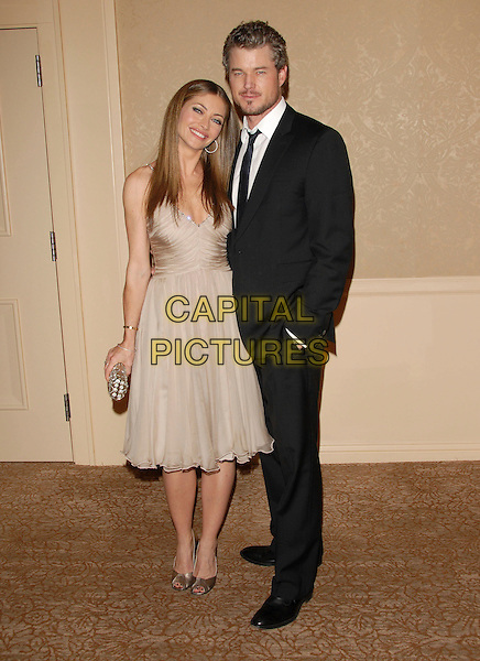 REBECCA GAYHEART & ERIC DANE.The Project Angel Food's Annual Divine Design Gala Awards Dinner held at The Beverly Hilton Hotel in Beverly Hills, California, USA. .November 29th, 2007.full length black suit beard facial hair beige dress clutch bag purse married husband wife .CAP/DVS.©Debbie VanStory/Capital Pictures