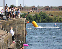 Saturday July 26th 2014 <br /> Pictured: Cardiff Bay <br /> RE: Boy dives into the water at Cardiff Bay during the heat wave