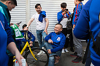 Fans of Chinese Super League football team Shanghai Shenhua wait outside the Worker's Stadium in Beijing before their team's game with Beijing Guo'an. 2nd April, 2017.