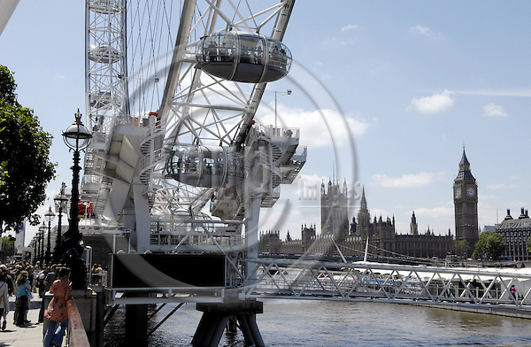 London - Great Britain / United Kingdom - 28 June 2008---London Eye, the big observation (Ferris) wheel, with Big Ben, Clock Tower at the Palace of Westminster / Houses of Parliament---tourism, architecture, landmark---Photo: Horst Wagner / eup-images