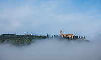 Sant'Anna in Camprena floating above the,  early morning fog. (Photo by Travel Photographer Matt Considine)