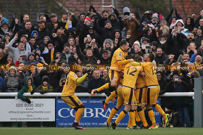 Sutton players congratulate Jamie Collins after scoring their opening goal during Sutton United  vs Leeds United, Emirates FA Cup Football at the Borough Sports Ground on 29th January 2017