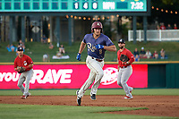 Frisco RoughRiders Preston Beck (8) runs back to first base during a Texas League game against the Springfield Cardinals on May 4, 2019 at Dr Pepper Ballpark in Frisco, Texas.  (Mike Augustin/Four Seam Images)