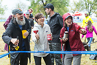 NWA Democrat-Gazette/BEN GOFF @NWABENGOFF<br /> Clint Thomas (from left), Alison Jumper and Natalie McBee, all of Fayetteville, cheer as racers compete in the UCI Elite Women event Sunday, Oct. 6, 2019, during the the Fayettecross cyclocross races at Centennial Park at Millsap Mountain in Fayetteville.