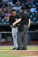 Manager Kyle Moore (2) of the Delmarva Shorebirds argues with home plate umpire Mitchell Leikam in a game against the Columbia Fireflies on Thursday, May 2, 2019, at Segra Park in Columbia, South Carolina. Delmarva won, 1-0. (Tom Priddy/Four Seam Images)