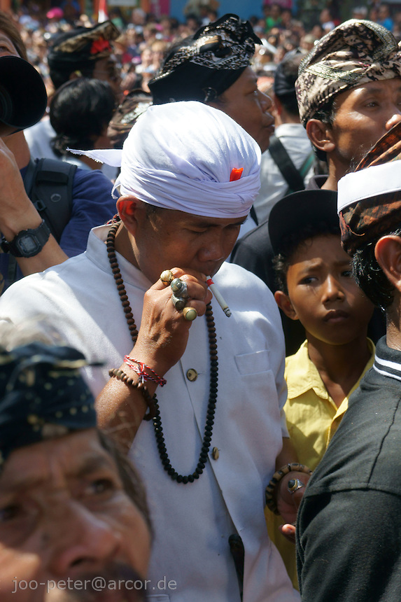 Brahman in white clothes and rings with magic power while ceremonies for cremation  of a royal family member, August 2011, Ubud, Bali, archipelago Indonesia