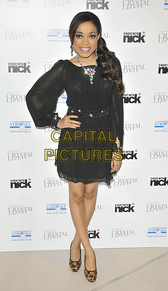 "Dionne Bromfield.The ""A Night With Nick"" charity event in aid of The Stroke Association, Swarovski CRYSTALLIZED, Gt. Marlborough St., London, England..December 6th, 2011.full length black sheer dress hand on hip necklace silver brown leopard print shoes .CAP/CAN.©Can Nguyen/Capital Pictures."