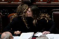 Ministri e sottosegretari si congratulano con la Ministra. Marianna Madia e Maria Elena Boschi si baciano<br /> Roma 18-12-2015 Camera. Mozione di sfiducia nei confronti del Ministro per le Riforme Costituzionali dopo il salvataggio di Banca Etruria.<br /> Photo Samantha Zucchi Insidefoto
