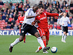 Middlesbrough's Jeremie Aliadiere and Derby's Darren Moore. during the Premier League match at the Riverside Stadium, Middlesbrough. Picture date 8th March 2008. Picture credit should read: Richard Lee/Sportimage