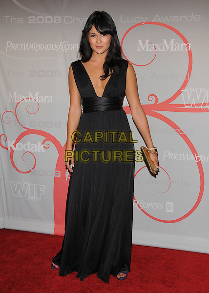 "GUEST.The 2008 Crystal & Lucy Awards ""A Black & White Gala"" held at The Beverly Hilton Hotel in Beverly Hills, California, USA..June 17th, 2008          .full length black white dress sash waist low cut neckline .CAP/DVS.©Debbie VanStory/Capital Pictures."