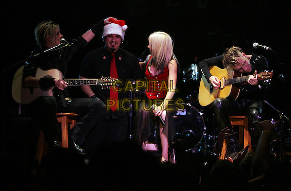 CARLTON BOST, CHRIS OLIVAS, TERRI NUNN & MITCHELL SIGMAN - BERLIN.Live in a co-headlining show with Bow Wow Wow at The House of Blues Anaheim in Anaheim, California .December 10th, 2004.stage, concert, live, music, singing, full length, acoustic.www.capitalpictures.com.sales@capitalpictures.com.Supplied By Capital PIctures