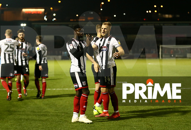 Harry Davis of Grimsby Town and Ahkeem Rose of Grimsby Town applaud the Grimsby fans after the Sky Bet League 2 match between Northampton Town and Grimsby Town at Sixfields Stadium, Northampton, England on 24 November 2018. Photo by Leila Coker / PRiME Media Images.
