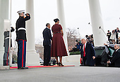 United States President Barack Obama and First Lady Michelle Obama welcome President-elect Donald Trump and his wife Melania to the White House prior to the inauguration in Washington, D.C. on January 20, 2017. Later today Donald Trump will be sworn-in as the 45th President. <br /> Credit: Kevin Dietsch / Pool via CNP