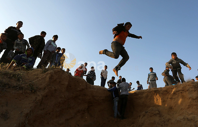 A Palestinian bedouin boy jumps during a rally marking the 41st anniversary of Land Day, in Deir el-Balah, Central Gaza Strip, on March 31, 2017.  Land Day marks the killing of six Arab Israelis during 1976 demonstrations against Israeli confiscations of Arab land. Photo by Ashraf Amra