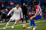 James Rodriguez of Real Madrid fights for the ball with Filipe Luis of Atletico de Madrid during their La Liga match between Atletico de Madrid and Real Madrid at the Vicente Calderón Stadium on 19 November 2016 in Madrid, Spain. Photo by Diego Gonzalez Souto / Power Sport Images