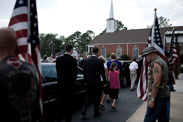 July 3, 2008. Washington, NC.. The funeral of Spc. Joel A. Taylor, assigned to the 1st Squadron, 3rd Armored Cavalry Regiment, Fort Hood, Texas; died June 25 in Mosul, Iraq, of wounds sustained when his vehicle encountered an improvised explosive device on June 24, 2008. He was 20.. Members of the Patriot Guard line the entrance to the funeral home as members of Spc. Taylor's family arrive.