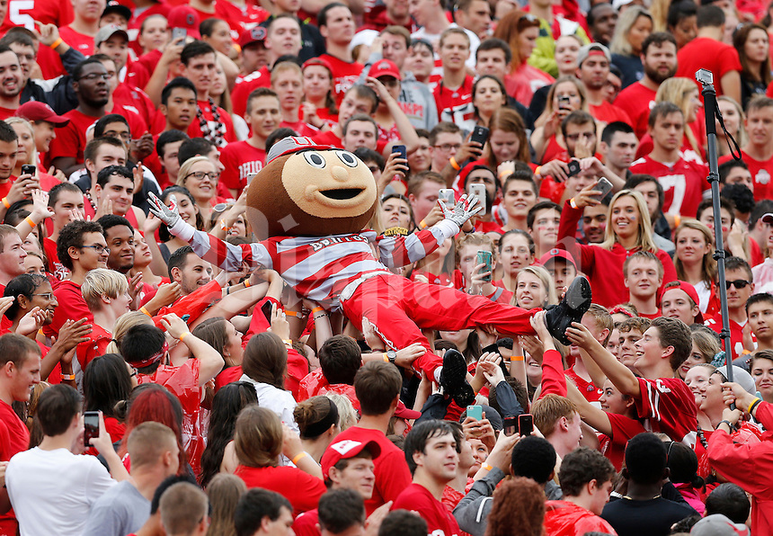 Brutus Buckeye crowd surfs through the Ohio State Block O section during the first quarter of the NCAA football game against the Northern Illinois Huskies at Ohio Stadium in Columbus on Sept. 19, 2015. (Adam Cairns / The Columbus Dispatch)