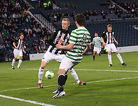 Bahrudin Atajic plays the ball through the legs of Ross Millen in the Dunfermline Athletic v Celtic Scottish Football Association Youth Cup Final match played at Hampden Park, Glasgow on 1.5.13. .