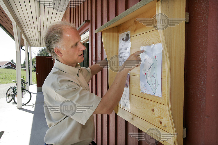 Govenor of the prison Øyvind Alnæs pointing out paths for walking and other details on a map of the island...Bastøy Prison/Horten/Norway. ©Fredrik Naumann/Felix Features
