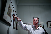 Nicholas Grindley shows part of his photography collection to guests during the Asian Art Week in New York. 11.03.2015. Eduardo MunozAlvarez/VIEWpress.