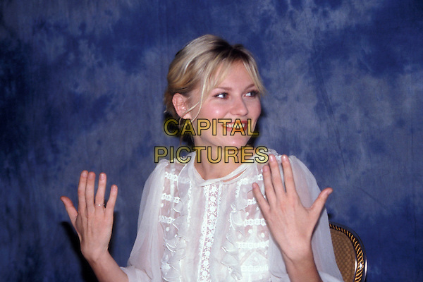 KIRSTEN DUNST.October 2005.Ref: AW.headshot portrait hands gesture.www.capitalpictures.com.sales@capitalpictures.com.© Capital Pictures.