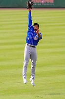 Biloxi Shuckers outfielder Corey Ray (1) makes a leaping catch while warming up in the outfield prior to a Southern League game against the Jackson Generals on July 26, 2018 at The Ballpark at Jackson in Jackson, Tennessee. Jackson defeated Biloxi 9-5. (Brad Krause/Four Seam Images)