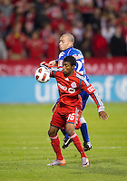 19 October 2010: Toronto FC Ashtone Morgan #36 battles with Arabe Unido Oscar Londono #27 during a CONCACAF game between Arabe Unido and Toronto FC at BMO Field in Toronto..Toronto FC won 1-0..