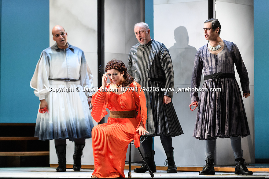 "English Touring Opera presents ""Ulysses' Homecoming"" at the Hackney Empire, prior to its UK tour. Picture shows: Adam Music (Amphimonous), Carolyn Dobbie (Penelope), andrew Slater (Antinous), Clint van der Linde (Pisander)"