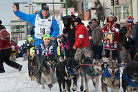 Ray Redington Jr and team leave the ceremonial start line with an Iditarider at 4th Avenue and D Street in downtown Anchorage, Alaska on Saturday, March 5th during the 2016 Iditarod race. Photo by Joshua Borough/SchultzPhoto.com