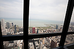 View through the window of the Willis Tower Skydeck, Chicago, IL