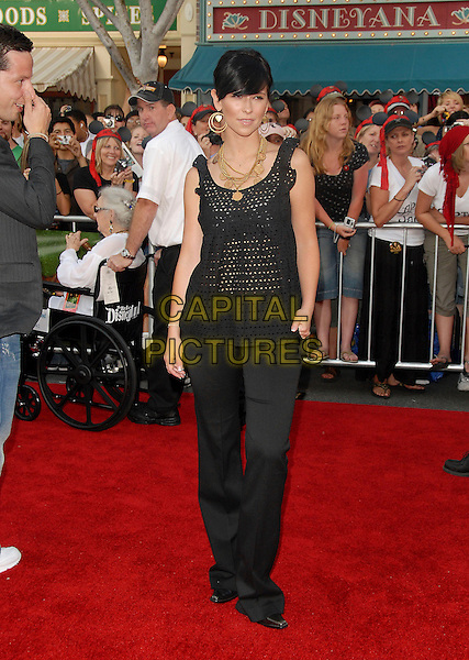 "JENNIIFER LOVE HEWITT & GUEST.attends Disney's ""Pirates of the Caribbean 2: Dead Man's Chest"" World Premiere held at Disneyland in Anaheim, .Los Angeles, California, USA, June 24th 2006. .full length black top gold jewellery hoop heart earrings necklaces trousers.Ref: DVS.www.capitalpictures.com.sales@capitalpictures.com.©Debbie VanStory/Capital Pictures"