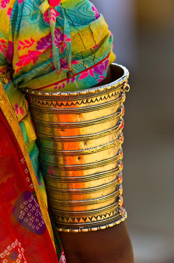 Rajasthani woman wearing ornate jewelry, at the bus station at Jaisalmer, Rajasthan, India