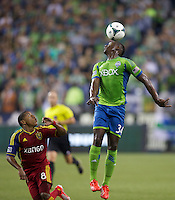 Jhon Kennedy Hurtado, right, heads the ball as Joao Plata defended during play at CenturyLink Field in Seattle Friday September 13, 2013. The Sounders won the match 2-0.