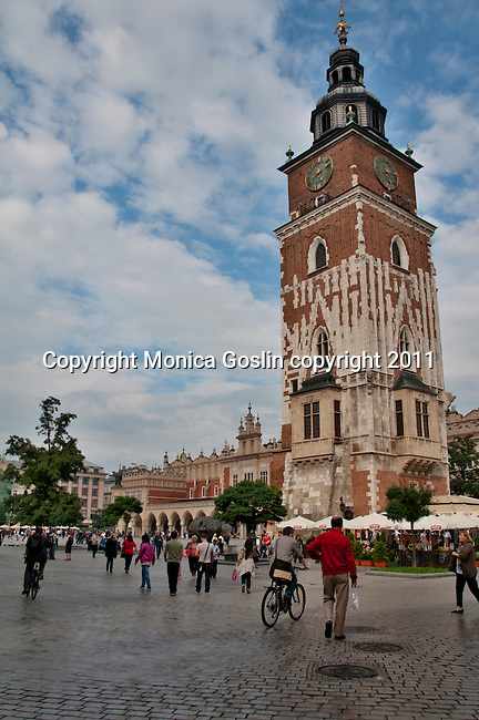 The Town Hall Tower in Krakow, Poland. The Main Market Square in Krakow, Poland is the largest medieval square in Europe and dates back to the 13th century