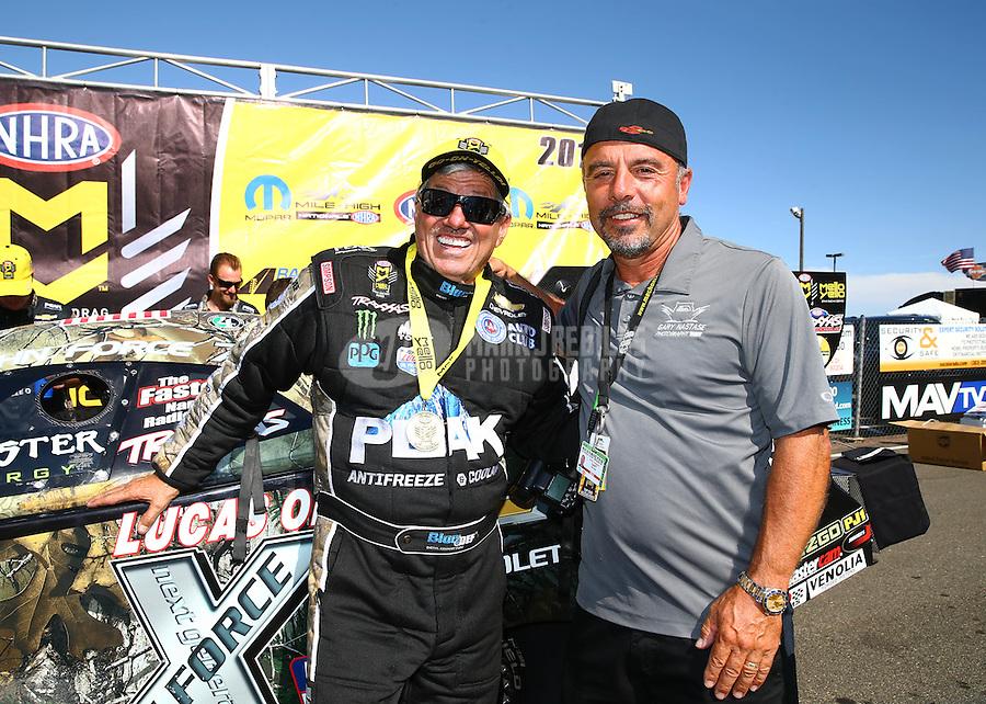 Jul 24, 2016; Morrison, CO, USA; NHRA funny car driver John Force celebrates with photographer Gary Nastase after winning the Mile High Nationals at Bandimere Speedway. Mandatory Credit: Mark J. Rebilas-USA TODAY Sports