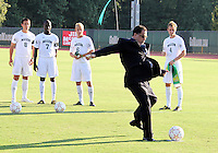 Danny Jordaan of South Africa takes a shot on goal during the visit of the FIFA World Cup 2018-2022 inspection delegation to George Mason University soccer practice facility.