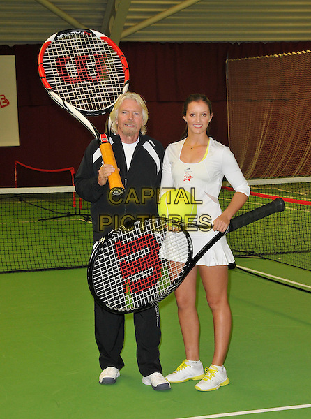 Sir Richard Branson & Laura Robson.Press conference & photocall where British tennis star, Laura Robson, becomes Virgin Active's first tennis ambassador & the face of Virgin Active's Junior Tennis Academy, Virgin Active Chiswick Riverside, London, England..February 26th, 2013.full length black tracksuit white skirt racquets  goatee facial hair giant oversized large ball .CAP/WIZ.© Wizard/Capital Pictures.