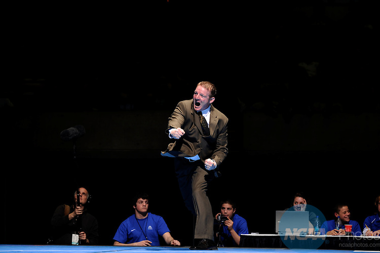 12 MAR 2011: The Chris Ortner assistant coach at  Wartburg celebrates Mark Corsello's victory in the 285 lbs championship during the Division III Men's Wrestling Championship held at the La Crosse Center in La Crosse Wisconsin. Stephen Nowland/NCAA Photos