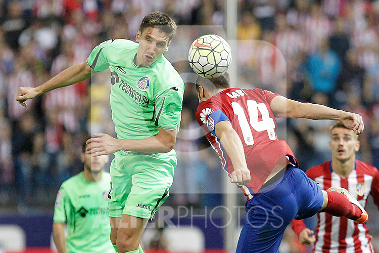 Atletico de Madrid's Gabi Fernandez (r) and Getafe's Stefan Scepovic during La Liga match.September 22,2015. (ALTERPHOTOS/Acero)