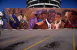 Capitol Records building with musicians mural in foreground parking lot, Hollywood, Los angeles, Califronia USA