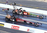 Jul 12, 2015; Joliet, IL, USA; NHRA top fuel driver Steve Torrence (near) races alongside Terry McMillen during the Route 66 Nationals at Route 66 Raceway. Mandatory Credit: Mark J. Rebilas-USA TODAY Sports