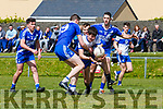 St Marys Liam O'Connell, Adam Quirke & Brian Sheehan quickly close down Desmonds Adam O'Donoghue who looses possession.