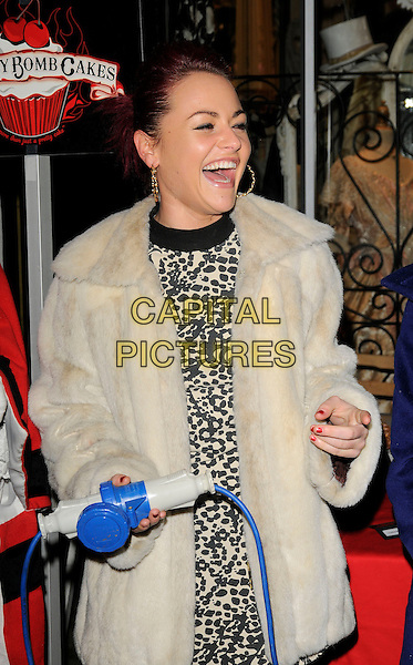 JAIME WINSTONE .The Camden Passage Christmas Lights Switch On, Camden Passage, London, England, November 29th 2008..xmas switch-on half length  jamie cream fur coat black tights leopard animal print mini dress gold hoop earrings hand mouth open laughing funny .CAP/CAN.©Can Nguyen/Capital Pictures