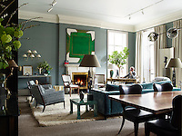 Interior designer Douglas Mackie at the writing desk designed by Jansen in a corner of his London living room