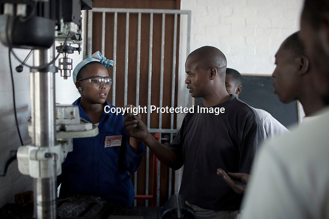 CAPE TOWN, SOUTH AFRICA - APRIL 20: Layanda Mduka, age 20, works in a car shop on April 20, 2012 in Cape Town, South Africa. She studies at a motor mechanics course who is dedicated to training five apprentices at a time, in motor car mechanics. The students come from poor backgrounds and have been unemployed until they cam here. iThemba Labantu offers these young men and women the opportunity to learn a trade so that they will be able to earn a living for themselves and their families one day. (Photo by Per-Anders Pettersson For Global Post)