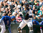 Texas Rangers'  base runner Leury Garcia picks himself up after being tagged out while trying to score from third by Seattle Mariners' catcher Jesus Montero in the fifth inning April 14, 2013 at Safeco Field in Seattle.  © 2013. Jim Bryant Photo. All Rights Reserved.