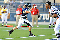 9 October 2010:  FIU quarterback Wesley Carroll (13) runs in a touchdown in the fourth quarter as the FIU Golden Panthers defeated the Western Kentucky Hilltoppers, 28-21, at FIU Stadium in Miami, Florida.